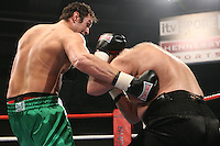 Tyson Fury (Manchester, green shorts) defeats Daniel Peret (Norway, black shorts) in a Heavyweight boxing contest at Norfolk Showground, Norwich, promoted by Hennessy Sports - 01/03/09 -Tyson Fury vs Daniil Peretyatko at the  Norwich Showground, Norwich 28th February 2009