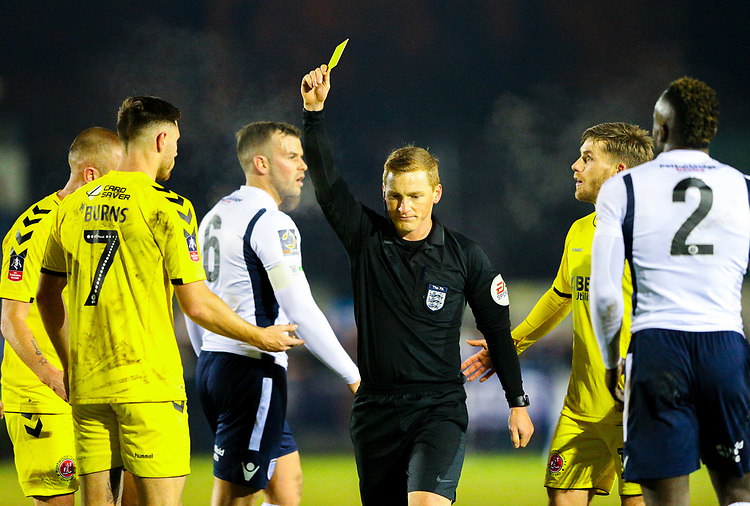Referee John Busby shows Fleetwood Town's Wes Burns the yellow card<br /> <br /> Photographer Alex Dodd/CameraSport<br /> <br /> The Emirates FA Cup Second Round - Guiseley v Fleetwood Town - Monday 3rd December 2018 - Nethermoor Park - Guiseley<br />  <br /> World Copyright &copy; 2018 CameraSport. All rights reserved. 43 Linden Ave. Countesthorpe. Leicester. England. LE8 5PG - Tel: +44 (0) 116 277 4147 - admin@camerasport.com - www.camerasport.com