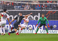Luka Jovic (Eintracht Frankfurt) setzt sich gegen Benjamin Pavard (VfB Stuttgart) durch - 31.03.2019: Eintracht Frankfurt vs. VfB Stuttgart, Commerzbank Arena, DISCLAIMER: DFL regulations prohibit any use of photographs as image sequences and/or quasi-video.