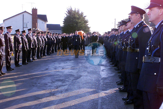 the remains of garda Sean Eiffe being brought to the grave yard in Ratoath village..Picture Fran Caffrey Newsfile.