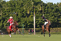 WELLINGTON, FL - DECEMBER 31:  Most Valuable Player Matt Coppola (black helmet), Coca Cola's Sugar Erskine (white helmet), sends the ball down the field, in the Tackeria's 12-11 win in the Herbie Pennell Cup Final, at the International Polo Club Palm Beach, on December 31, 2017 in Wellington, Florida. (Photo by Liz Lamont/Eclipse Sportswire/Getty Images)