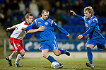 St Johnstone v Inverness Caley Thistle....02.01.11  .Dave Mackay gets away a shot at goal despite the efforts of Chris Innes.Picture by Graeme Hart..Copyright Perthshire Picture Agency.Tel: 01738 623350  Mobile: 07990 594431