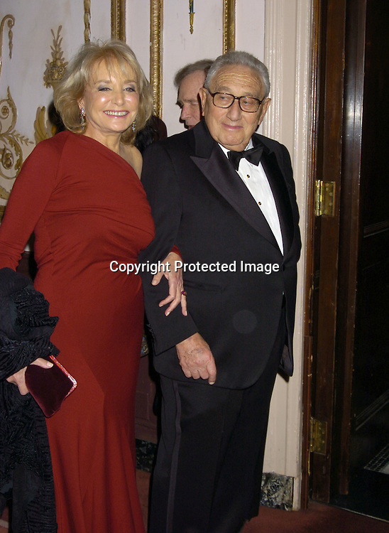 Barbara Walters and Dr Henry Kissinger..at The Museum of TV and Radio New York Gala  honoring  Merv Griffin on May 26, 2005 at The Waldorf Astoria Hotel...Photo by Robin Platzer, Twin Images
