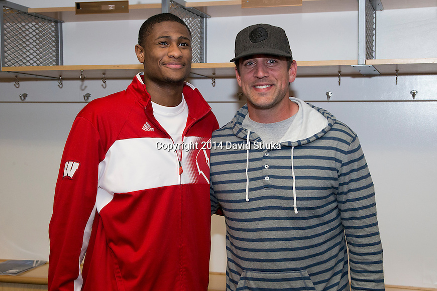Wisconsin Badgers Riley Dearring with Green Bay Packers quarterback Aaron Rodgers after  a regional semifinal NCAA college basketball tournament game against the Baylor Bears Thursday, March 27, 2014 in Anaheim, California. The Badgers won 69-52. (Photo by David Stluka)