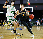 SIOUX FALLS, SD - MARCH 8: Matt Holba #13 of the PFW Mastodons drives to the basket past Kienan Walter #23 of the North Dakota Fighting Hawks at the 2020 Summit League Basketball Championship in Sioux Falls, SD. (Photo by Richard Carlson/Inertia)