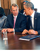United States President Barack Obama meets with bipartisan Members of Congress in the Cabinet Room of the White House in Washington, D.C. on September 3, 2013. From left to right:  Speaker of the U.S. House John Boehner (Republican of Ohio); President Obama. <br /> Credit: Dennis Brack / Pool via CNP