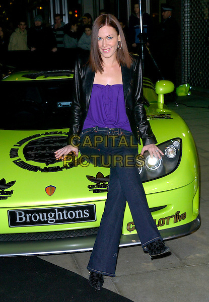 LINZI STOPPARD.The Gumball 3000 Miles - film premiere, KOKO, London, UK..November 30th, 2006.full length car jeans denim purple top black leather jacket legs crossed.CAP/CAN.©Can Nguyen/Capital Pictures