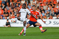 Jordan Green of Newport County (left) and Dan Potts of Luton Town during the Sky Bet League 2 match between Luton Town and Newport County at Kenilworth Road, Luton, England on 16 August 2016. Photo by David Horn.