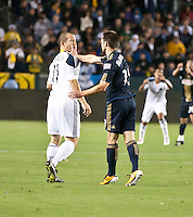 CARSON, CA – April 2, 2011: Philadelphia Union forward Jack McInerney (19) hits LA Galaxy forward Chad Barrett (11) during the match between LA Galaxy and Philadelphia Union at the Home Depot Center, March 26, 2011 in Carson, California. This hit results in a red card for McInerney. Final score LA Galaxy 1, Philadelphia Union 0.