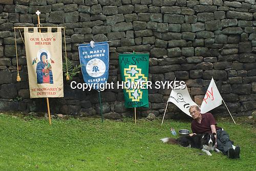The annual Padley Martyrs Roman Catholic Pilgrimage. Padley, Padley Chapel, Grindleford, Derbyshire  UK 2008. man and dog.