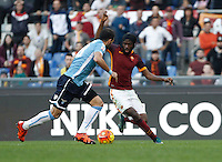 Calcio, Serie A: Roma vs Lazio. Roma, stadio Olimpico, 8 novembre 2015.<br /> Roma's Gervinho, right, is challenged by Lazio's Santiago Gentiletti during the Italian Serie A football match between Roma and Lazio at Rome's Olympic stadium, 8 November 2015.<br /> UPDATE IMAGES PRESS/Isabella Bonotto