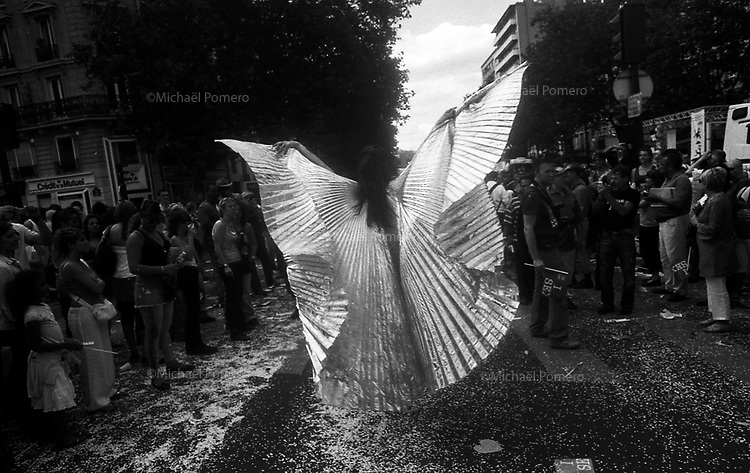 27.06.2009<br /> <br /> Transexual dressed in butterfly walking in the middle of the crowd during the gay pride.<br /> <br /> Transexuel en papillon marchant au milieu de la foule pendant la gay pride.