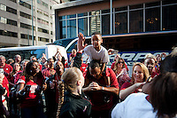 DENVER, CO--Lindy LaRocque high fives a young fan before boarding the bus at the Brown Palace hotel before the semifinals of the 2012 NCAA Women's Final Four in Denver, CO.