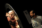 A visitor inspects an installation at the opening of the controversial Body Worlds exhibition of human anatomy at Haifa's MadaTech, April 6, 2009. The German exhibition of preserved cadavers in various poses meant to explain the intricacies of the human body and the differences between healthy and unhealthy organs, has drawn the ire rabbis and Israel's religious public who say it is disrespectful of the dead. Members of Israel's Zaka, a service staffed by Orthodox Jews known for collecting the body parts of people killed in terror attacks showed up for the opening. Those exhibited donated their corpses to science. Photo by: Moran Mayan/JINI