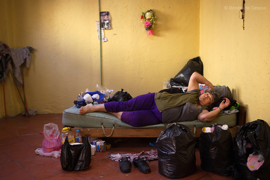 Amalia, a resident of Casa Xochiquetzal, rests in er bedroom at the shelter in Mexico City, Mexico on April 25, 2012. Amalia, 66, is from Michoacán and came to Casa Xochiquetzal when it first opened its doors. She wears a wig and pads her bra. She is very animated; words and songs come easily to her. She has also suffered from schizophrenia for 22 years, but despite hearing voices, she works hard not to lose touch with reality. As a way of earning a little money, she gathers plastic bottles to recycle and also helps to sell clothes in a stand operated by her boyfriend of 31 years. Casa Xochiquetzal is a shelter for elderly sex workers in Mexico City. It gives the women refuge, food, health services, a space to learn about their human rights and courses to help them rediscover their self-confidence and deal with traumatic aspects of their lives. Casa Xochiquetzal provides a space to age with dignity for a group of vulnerable women who are often invisible to society at large. It is the only such shelter existing in Latin America. Photo by Bénédicte Desrus