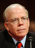 Washington, D.C. - March 24, 2004 -- United States Deputy Director of Central Intelligence John E. McLaughlin testifies before The National Commission on Terrorist Attacks Upon the United States (also known as the 9-11 Commission) in Washington, D.C. on March 24, 2004.<br /> Credit: Ron Sachs / CNP<br /> [RESTRICTION: No New York Metro or other Newspapers within a 75 mile radius of New York City]