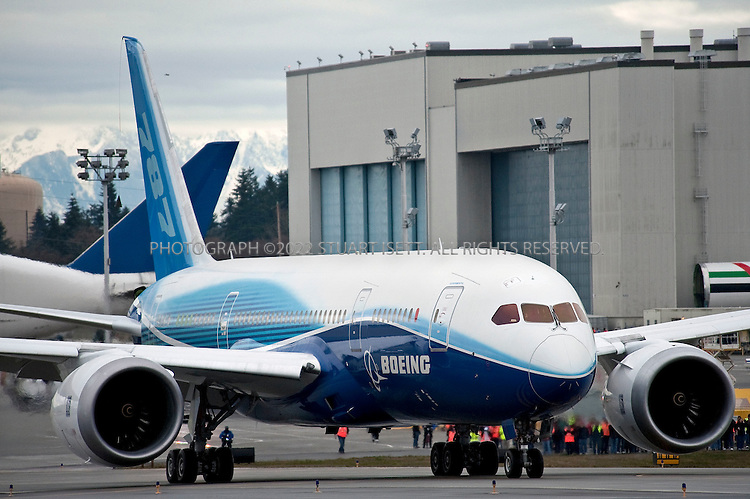 12/15/2009--Everett, WA, USA..The Boeing 787 Dreamliner taxis to the runway to prepare to take off on its maiden flight from Paine Field, WASH...The Boeing 787 Dreamliner is a mid-sized, wide body, twin engined jet airliner currently under development by Boeing .It will carry between 210 and 330 passengers depending on the seating configuration. Boeing has stated that it will be more fuel-efficient than comparable earlier Boeing airliners. It will also be the first major airliner to use composite material for most of its construction. Boeing claims that the 787 will be up to 20% more fuel-efficient than current comparable aircraft. ..50% of the aircraft's weight are from the composite materials shown here. Composite materials are significantly lighter and stronger than traditional aircraft materials, making the 787 a very light aircraft for its capabilities. By volume, the 787 will be 80% composite. This will allow the potential to take off from, and land on, relatively short airstrips as the 767 can, yet still have the capability to fly long-haul distances....©2009 Stuart Isett. All rights reserved