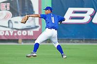 Burlington Royals right fielder Chris Elder #11 makes a throw during practice at Burlington Athletic Park on June 15, 2012 in Burlington, North Carolina.  (Brian Westerholt/Four Seam Images)