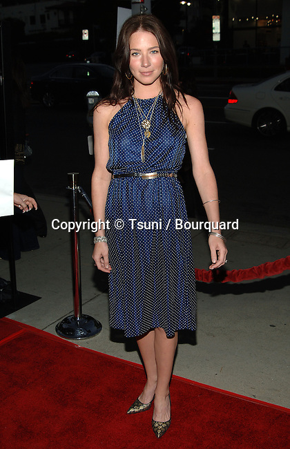 Lynn Collins - <br /> Stop Loss Premiere at the DGA Theatre in Los Angeles.<br /> <br /> full length<br /> eye contact