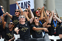 NEW YORK, NY - JULY 10: Megan Rapinoe, Alex Morgan and teammates of the United States Women's National Soccer team clap during a celebration of their fourth World Cup championship at City Hall on July 10, 2019 in New York, NY. The ceremony followed a ticker tape parade down the Canyon of Heroes on Broadway.