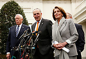 United States Senate Minority Leader Chuck Schumer (Democrat of New York), center, briefs reporters following a meeting with the president and congressional leaders on the government shutdown, at the White House, in Washington, D.C., January 9, 2019. Flanking Schumer are US House Majority Leader Steny Hoyer (Democrat of Maryland), left, and Speaker of the US House of Representatives Nancy Pelosi (Democrat of California), right<br /> Credit: Martin H. Simon / CNP