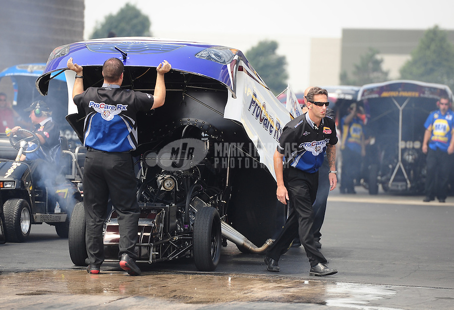 Jul, 10, 2011; Joliet, IL, USA: NHRA funny car driver Melanie Troxel with crew members during the Route 66 Nationals at Route 66 Raceway. Mandatory Credit: Mark J. Rebilas-