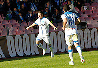 Simone Verdi  celebrates after scoring   in action during the Italian Serie A soccer match between   SSC Napoli and Empolii    at San Paolo   stadium in Naples , December 07, 2014