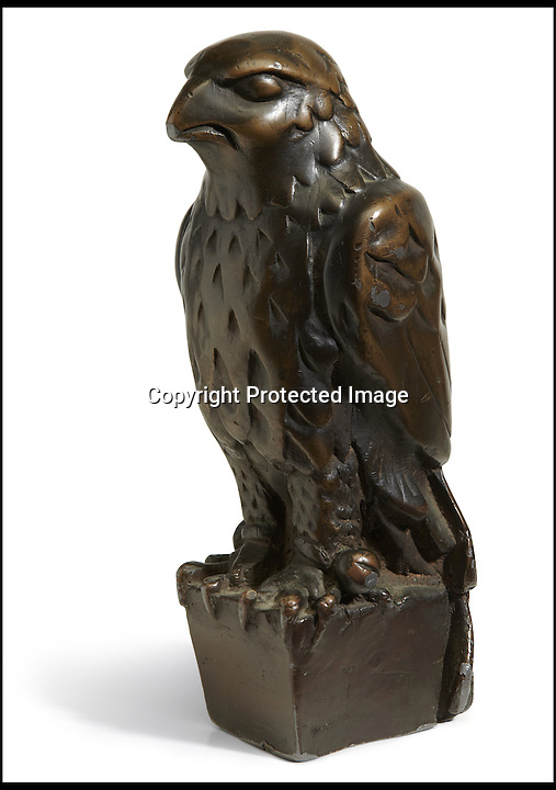 BNPS.co.uk (01202) 558833<br /> Picture: Bonhams/BNPS<br /> <br /> A lead statue of a bird which turned out to be a worthless dud in the Hollywood film The Maltese Falcon has sold for a whopping £2.5 million.<br /> <br /> The 12-inch falcon was the object of desire of Humphrey Bogart's private detective character, who wrongly believed it to be a priceless, jewel-encrusted gold antique.<br /> <br /> Experts had expected it to sell for £1 million but it was snapped up by an anonymous bidder for £2.5 million at the Bonhams sale in New York.