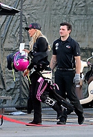 Feb 9, 2019; Pomona, CA, USA; NHRA top fuel driver Leah Pritchett and crew member during qualifying for the Winternationals at Auto Club Raceway at Pomona. Mandatory Credit: Mark J. Rebilas-USA TODAY Sports