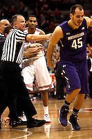 Ohio State Buckeyes forward LaQuinton Ross (10) is held back by referees and coaches while Northwestern Wildcats forward Nikola Cerina (45) is pushed away during a skirmish in the second half of their game against the Northwestern Wildcats at the Value City Arena in Columbus, Ohio on February 19, 2014. (Columbus Dispatch photo by Brooke LaValley)