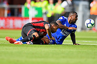 Callum Wilson of AFC Bournemouth and Wes Morgan of Leicester City vie fr the ball during AFC Bournemouth vs Leicester City, Premier League Football at the Vitality Stadium on 15th September 2018