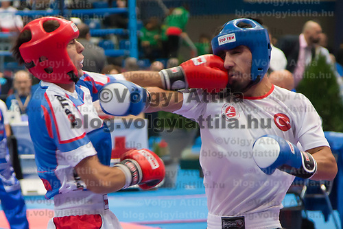 Alexey Trifonov (in red) of Russia and Ozbek Birhan (in blue) of Turkey fight in the men's -57 kg preliminary during the WAKO World Kick-boxing Championships in Budapest, Hungary on Nov. 6, 2017. ATTILA VOLGYI