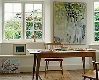 Artist Patrick Heron's abstract art mixes with children's paintings in this light-filled room