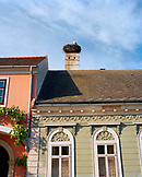 AUSTRIA, Rust, storks nest in a rooftop chimney in the center of town, Burgenland