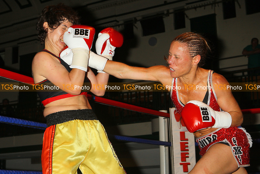 Laura Saperstein (red shorts) defeats Borislava Goranova in a Super-Featherweight boxing contest at York Hall, Bethnal Green, promoted by Left Jab / Miranda Carter - 20/06/10 - MANDATORY CREDIT: Gavin Ellis/TGSPHOTO - Self billing applies where appropriate - Tel: 0845 094 6026