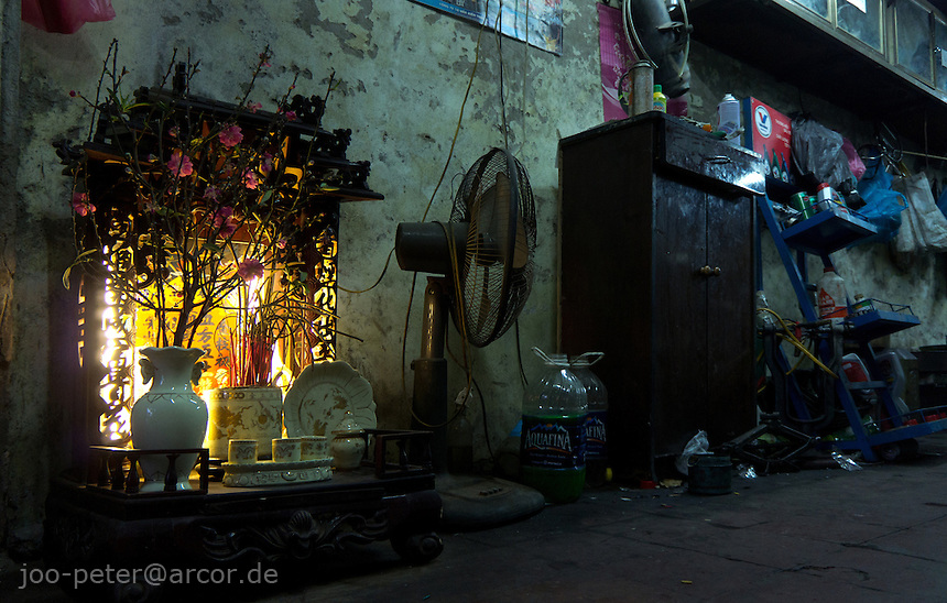 shrine in a small workshop of Hanoi, Vietnam