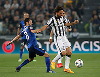 Calcio, quarti di finale di andata di Champions League: Juventus vs Monaco. Torino, Juventus stadium, 14 aprile 2015.<br /> Juventus' Andrea Pirlo, right, is challenged by Monaco's Joao Moutinho during the Champions League quarterfinals first leg football match between Juventus and Monaco at Juventus stadium, 14 April 2015.<br /> UPDATE IMAGES PRESS/Isabella Bonotto