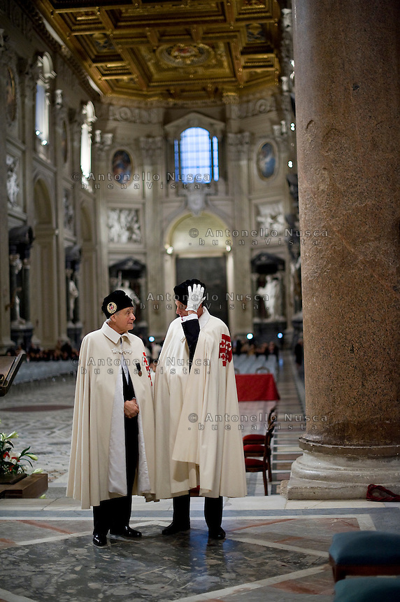 Roma, 17 Dicembre, 2011. Cerimonia per l'ordinazione dei nuovi cavalieri del Sovrano Ordine del Santo Sepolcro di Gerusalemme nella Basilica di San Giovanni..The ceremony for the ordination of the new knights of the Equestrian Order of the Holy Sepulchre of Jerusalem (EOHSJ) at the Saint John Basilica in Rome..The EOHSJ was founded in 1099 in Jerusalem as a religious-military Order of the Catholic Church to guard the Holy Sepulchre and to help the Christians in the Holy Land..The Grand Master Emeritus of the Equestrian Order of the Holy Sepulchre of Jerusalem, Cardinal John Patrick Foley, died on December 10 in Philadelphia, Usa.