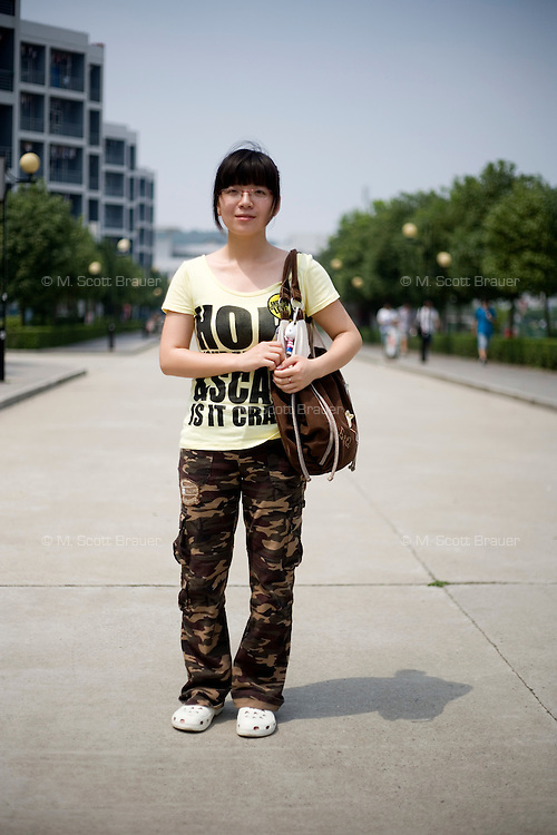 Zhaoyin, a student, age 20, poses for a portrait in Nanjing. Response to 'What does China mean to you?': 'China is a developed country that still has many problems,but it must continue to develop.'  Response to 'What is your role in China's future?': 'Right now I am still a student. But in the future I hope to become a teacher.To make a contribution to the education system of my homeland.'