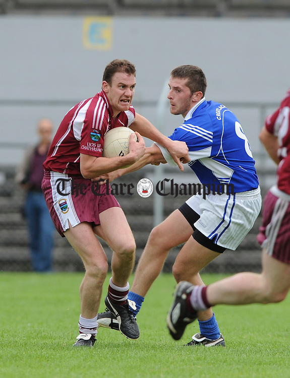 Danny Lynch of Lissycasey in action against Michael Hawes of Cratloe during their game at Cusack park. Photograph by John Kelly.