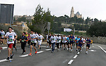 Marathon runners leave the Old City of Jerusalem during the Jerusalem Marathon, in Jerusalem, 16 March 2012. It is the second year the Jerusalem Marathon has been organized and the three events, a full marathon, a half marathon and a 10 kilometers run, attracted some 15,000 participants on a chilly and rainy day in Jerusalem. Photo by Mahfouz Abu Turk