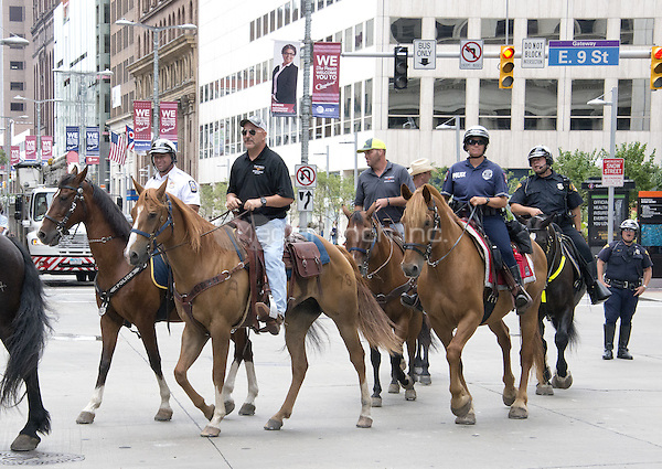 Police and security people on horseback on Euclid Street near the Quicken Loans Arena, site of the 2016 Republican National Convention, on Saturday, July 16, 2016.<br /> Credit: Ron Sachs / CNP/MediaPunch<br /> (RESTRICTION: NO New York or New Jersey Newspapers or newspapers within a 75 mile radius of New York City)