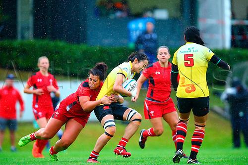 23.08.2015. Dublin, Ireland. Women's Sevens Series Qualifier 2015. Wales versus China<br /> Shona Powell-Hughes (Wales) tackles Qishi Guan (China).