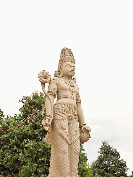 An 18 foot statue of Bodhisattva Avalokitesvara at the Kelaniya Temple in Kelaniya, Sri Lanka. The Kelaniya Raja Maha Vihara or Kelaniya Temple is a Buddhist temple in Kelaniya, Sri Lanka, seven miles from Colombo. The spot on which this temple stands derived its sanctity in the Buddhist era 2531, with the third visit of the Buddha to this country.Over 70 percent of Sri Lanka's population practices Buddhism.