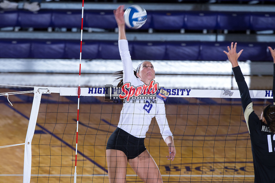 Camryn Freiberg (21) of the High Point Panthers attacks the ball during the match against the Wake Forest Demon Deacons at the Panther Invitational at the Millis Athletic Center on September 12, 2015 in High Point, North Carolina.  The Demon Deacons defeated the Panthers 3-1.   (Brian Westerholt/Sports On Film)