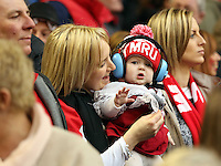 Pictured: A mother with her young child, both Wales supporters celebrate their team's win Saturday 14 March 2015<br />