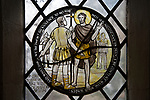 Church of John the Baptist, Barnby, Suffolk, England, UK stained glass roundel window by Margaret Edith Aldrich Rope Saint John the Baptist and Roman soldier