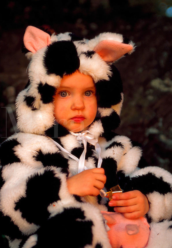 Baby girl in cow costume.