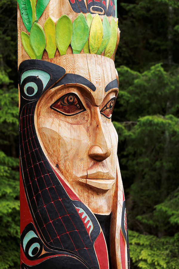 Carved face of Mother Earth on Wooch Jin Dul Shat Kooteeya totem pole, Sitka National Historical Park, Sitka, Alaska, USA