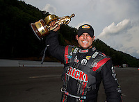 Jun 21, 2015; Bristol, TN, USA; NHRA funny car driver Matt Hagan celebrates after winning the Thunder Valley Nationals at Bristol Dragway. Mandatory Credit: Mark J. Rebilas-USA TODAY Sports